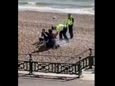 Coronavirus: Police pour water over BBQ after beach-goers